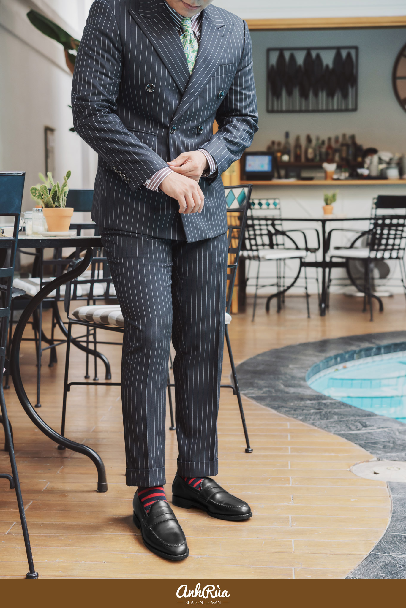 Black stripe double breasted suit với Black Penny Loafers